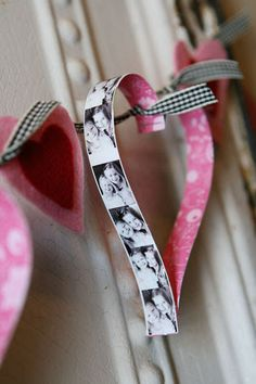 Heart garland - I didn't use photo strips (I wasn't sure how to print them?) but instead used a variety of pink & red scrapbook papers... turned out really cute!  Punched holes and threaded in pink yarn to make it a garland for my mantle