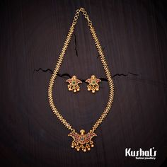 Elegantly crafted necklace studded with ruby and green stones and plated with polish Gold Temple Jewellery, Gold Jewellery Design, Gold Jewelry Simple, Simple Necklace, Ruby Necklace Designs, Antique Necklace, Gold Necklace, Wedding Jewelry, Jewelry Gifts