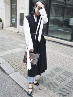 layering clothes: Shini Park layering turn-up jeans under a dress