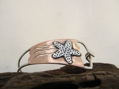 Starfish cuff,  hand fabricated mixed metal sterling silver and copper cuff $75.00  by JoDeneMoneuseJewelry on Etsy