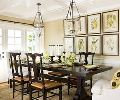 The large framed art really helps with large walls to make this traditional dining room complete.