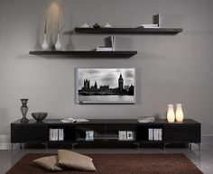 Floating shelves above TV. Must do!