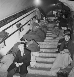 Elephant and Castle Underground Station Shelter: Men and women bedded down for the night on either side of a staircase.