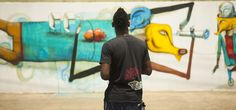 Wendell McShine (Trinidad and Tobago artist) in front of one of his murals