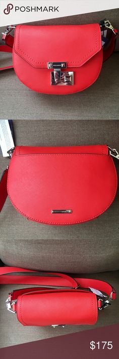 """Rebecca Minkoff Paris Saddle Bag Electric Red Rebecca Minkoff Paris Saddle Bag in Electric Red.  NWT Retail:  $295.  This color sold out fast!  Gorgeous, vibrant shade of this season's It color.  Get your fall red on!   Leather exterior with fabric lining Flap top with push lock closure Detachable adjustable shoulder strap/crossbody Exterior slit pocket Interior slit pocket Measures approx 9"""" W x 7"""" H x 3"""" D  Dust bag included.  Some scratches on push lock, not noticeable when worn.  Please…"""
