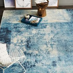 Distressed Rococo Wool Rug #westelm This blue rug would lend to the stainless kitchen chairs and allow us to do a great colorful accent wall