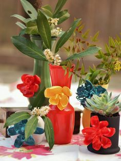 Spoon Flower Vases made from melting plastic spoons, hot glue, dollar tree vases and spray paint! Who knew! Neat idea!