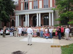 Pontiac Mayor, Bob Russell, greets car club members in front of county courthouse.