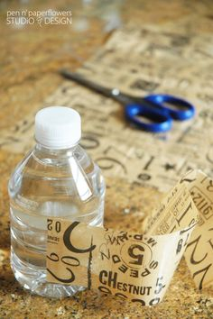 Tissue Paper + clear packing tape = custom wrapped water bottles. Great idea for coordinating with any event/party.