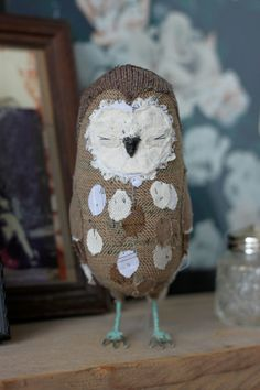 This is Ponsenby, a very sweet little owl who measures approx 18cm in height. He is painstakingly detailed with layer upon layer of fabric scraps and tiny hand stitches. He is crafted entirely by me and it utterly, utterly unique. He is made in a variety of browns and natural cream tones, in fabrics both new and reused.