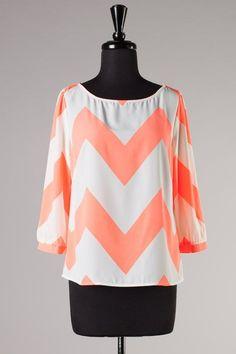 $42 - Neon coral chevron blouse