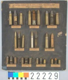 Cartridge board at the Dutch Police Museum. it was made by Staatsbedrijf der Artillerie-Inrichtingen and donated in 1920 to the now closed Genootschap voor een Politiemuseum. On the bottom it shows the 12mm ball load and shot load pinfire cartridges that were made for the Dutch Customs officials (grenscommiezen) at the borders.