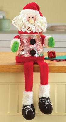 Christmas Treat Jar-Sitting Snowman Shelf Sitter Charming Sitting Snowman holds your favorite treats while also being an adorably festive decoration on a counter or windowsill. Head, arms & dangling legs are made of colorful fabric. The plastic jar unscrews for easy filling. Hand wash jar. Plastic/polyester. Jar is 4″Dia x 5 1/2″H with top. Feet dangle 11″. http://kittykatkoutique.com/christmas-treat-jar-sitting-snowman-shelf-sitter/