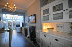 Shabby Chic style open plan, kitchen/diner/family room. Features Dulux Green Slate paint. Decoration by Andrew Batey and Sons