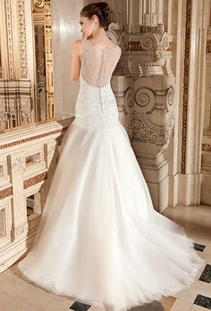Brides: Demetrios - Ilissa. This glamorous, fit-and-flare, sleeveless gown features a tulle skirt, illusion neckline and shimmering bodice embellished with crystal beading. The low illusion back is finished with buttons and a sweep train.