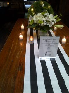 wedding reception with custom bar menu and striped table runner