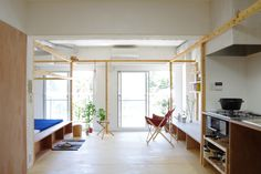 frame-house-peak-studio-kawasaki-japan-living-room-facing-patio-doors-humble-homes