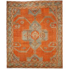 Antique Turkish Oushak Area Rug 13'02  X 15'06 | Let this Oushak with its evocative pattern and antique texture add an exotic presence to your space. The background is a vibrant orange and has a powder blue border and center medallion. Warm up nearly any space with this antique Turkish Oushak carpet in vibrant shades of reddish orange and slate blue grey.