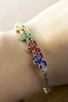 Awareness is on the rise! Our puzzle piece bracelet captures the autism community's spirit of unity with colorful flair and vibrant crystals.