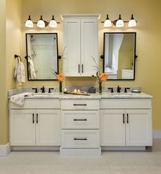 Maine oceanfront cottage master bathroom with double vanity; white beaded inset cabinetry