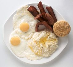 Grits and eggs with bacon and buttermilk biscuit