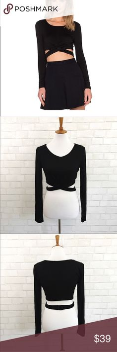 Lovers & Friends black long sleeve wrap crop top Lovers & Friends black long sleeve wrap around crop top size medium. 95% rayon 5% elastane Wrap around straps with S-hook closure Lovers + Friends Tops Crop Tops