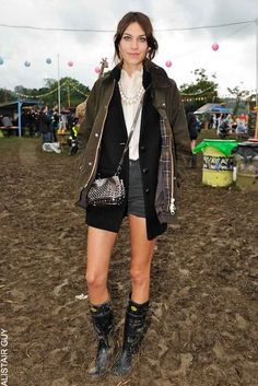 Alexa Chung shows off her enviable festival style in a Barbour jacket & Superga Wellies paired with a pearl necklace