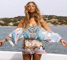 Beyonce Stuns In Floral Romper while on vacation in Europe