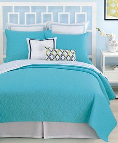 Everything Turquoise: Bedding  Throw folded at the end of the bed made with all white bedding, pillows for a punch of color mixed with the all white pillows.