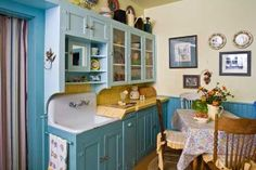 The cabinets and sink in this colorful farmhouse kitchen date to a 1930s remodel. (Photo: Scot Zimmerman)