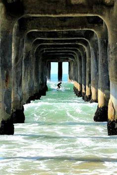 Surfing under the dock