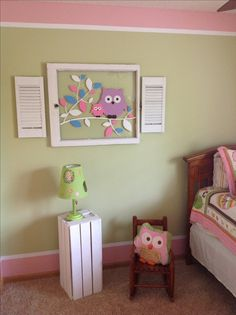 Used an old window put a branch and owls on (using a wall decal). Then painted old shutters for the sides. And painted wood crate white for lamp table. Painted border in room for a cute new look! Great or little girls room!