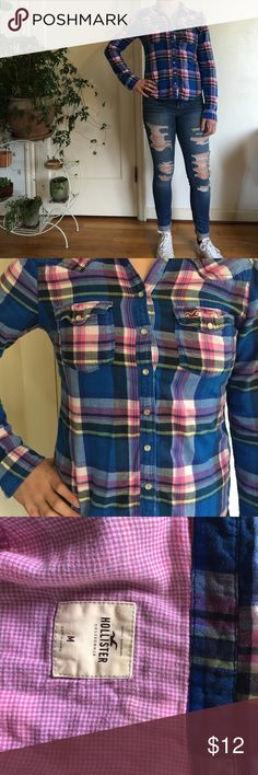 HOLLISTER Blue and Pink Flannel Super cute Hollister flannel. Blue plaid on outside, pink check on inside and inside of pockets. Super comfy for school or weekend brunches, with skinny jeans and converse. Size Medium, fits like a Small. Please no trades! Any reasonable offer will be considered. Hollister Tops Button Down Shirts