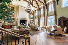 Tyler Perry's Atlanta home great room boasts double-height ceilings and a grand fireplace.