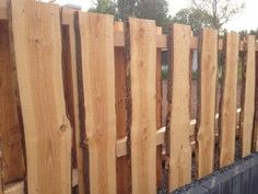 Beautiful garden fence Property fence made of tree trunk cuts tree slices very beautiful and very stable