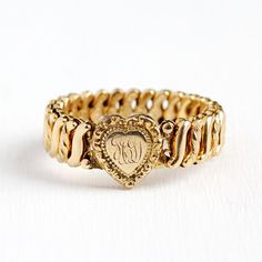 """Charming vintage 12k rosy yellow gold filled expansion bracelet. This sweet bracelet features a repousse heart center containing the initials GCD. The expansion bracelet design enables it to stretch to fit over the hand and fit the wrist with precision. It is comprised of """"S"""" shaped"""