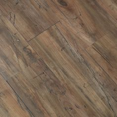 This durable laminate flooring is easy to install and lasts a lifetime. Made with a wood grain look, it will stand up to more wear than an actual wood floor at a fraction of the cost.