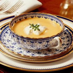 Sweet Potato Soup with Rum Cream | This creamy fall soup is quite a treat! Maple syrup, nutmeg, and sweet potatoes give it all the flavors of fall. Add a dollop of a citrus-flavored rum cream for a final touch. | #Recipes | SouthernLiving.com
