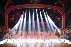 The women dance.