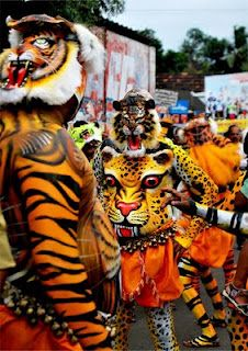 "Puli Kali : A popular folk art form in Kerala during Onam festival. (""Puli"" = Leopard/Tiger & ""Kali"" = Play in Malayalam language)"