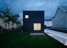 Villa Wot is a stone house punctured by different sized windows
