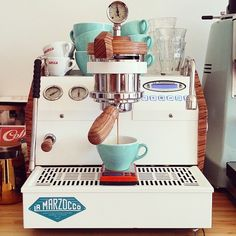 Nearly $8,000 custom GS3 from La Marzocco. Haha. This would look awesome in our kitchen, though. ;)