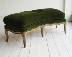 A CHARMING LOUIS XV STYLE CURVED STOOL the hand-stitched horsehair upholstery and pure down cushion, recovered in antique green velvet. French c. 1850