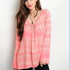 Tribal Bohemian Bell Sleeve Top Bohemian bell sleeves top with an tribal ethnic print and tie strings on the necklineSizes: S M L available. Leave comment with size to purchase. Tops Blouses