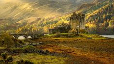 Eilean Donan Castle - Eilean Donan is one of Scotland's most evocative castles. It is located at the entrance to Loch Duich, on an islet linked to the mainland by a stone-arched bridge. Monuments, Right Here Waiting, Richard Marx, Eilean Donan, Beautiful Landscapes, Entrance, Explore, Mountains, History