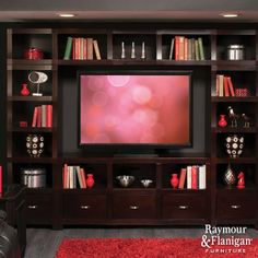 Set the Stage | An entertainment wall with closed storage provides a place to store your film collection and leaves plenty of room to display your favorite items.