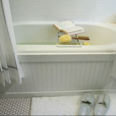 Bathtub. Need to do this to the front of our tub and get rid of the ugly 80's marble.