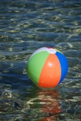 A beach ball in the water.