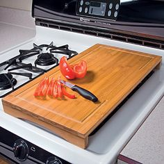 Bamboo Over Sink Cutting Board adds workspace by straddling your sink -- or use it as an over-the-stove cutting board since it easily covers two stove burners.