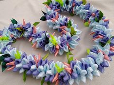 "The lei is approximately 37 inches long material/ 7/8"" satin ribbon/organza ribbon"